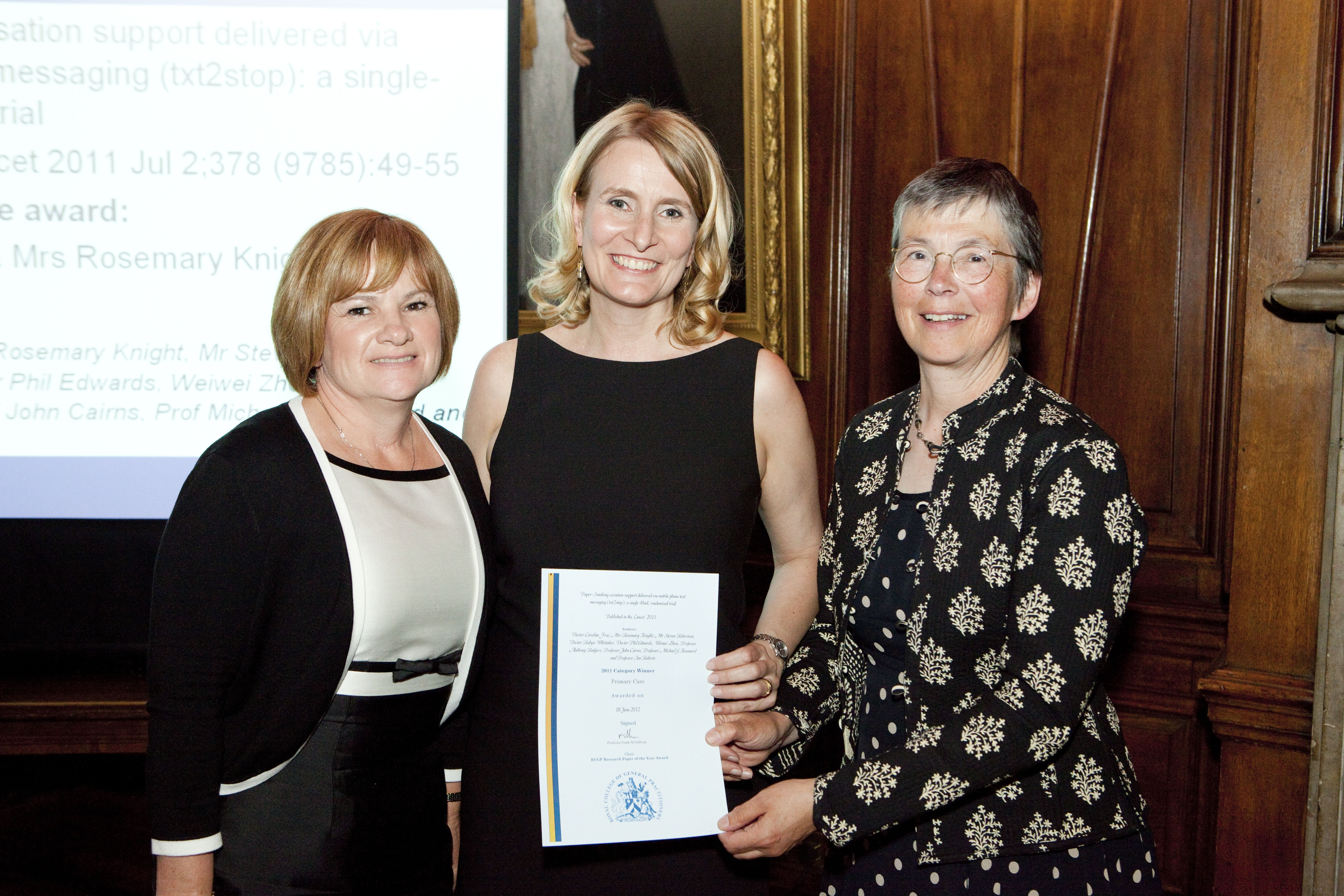 Dr Caroline Free and Mrs Rosemary Knight receiving the Research Paper of the Year Award from Dr Iona Heath, RCGP President