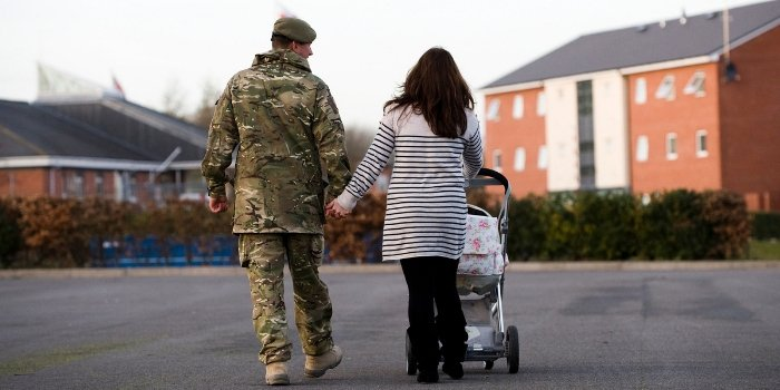 Picture of soldier returning home to young family